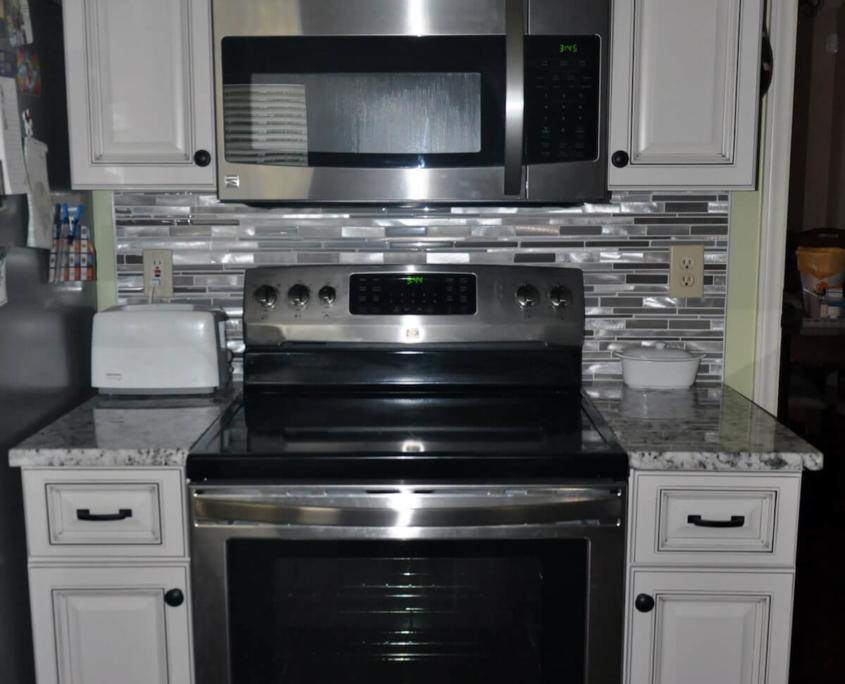 Stainless steel appliances and white cabinets greensboro nc