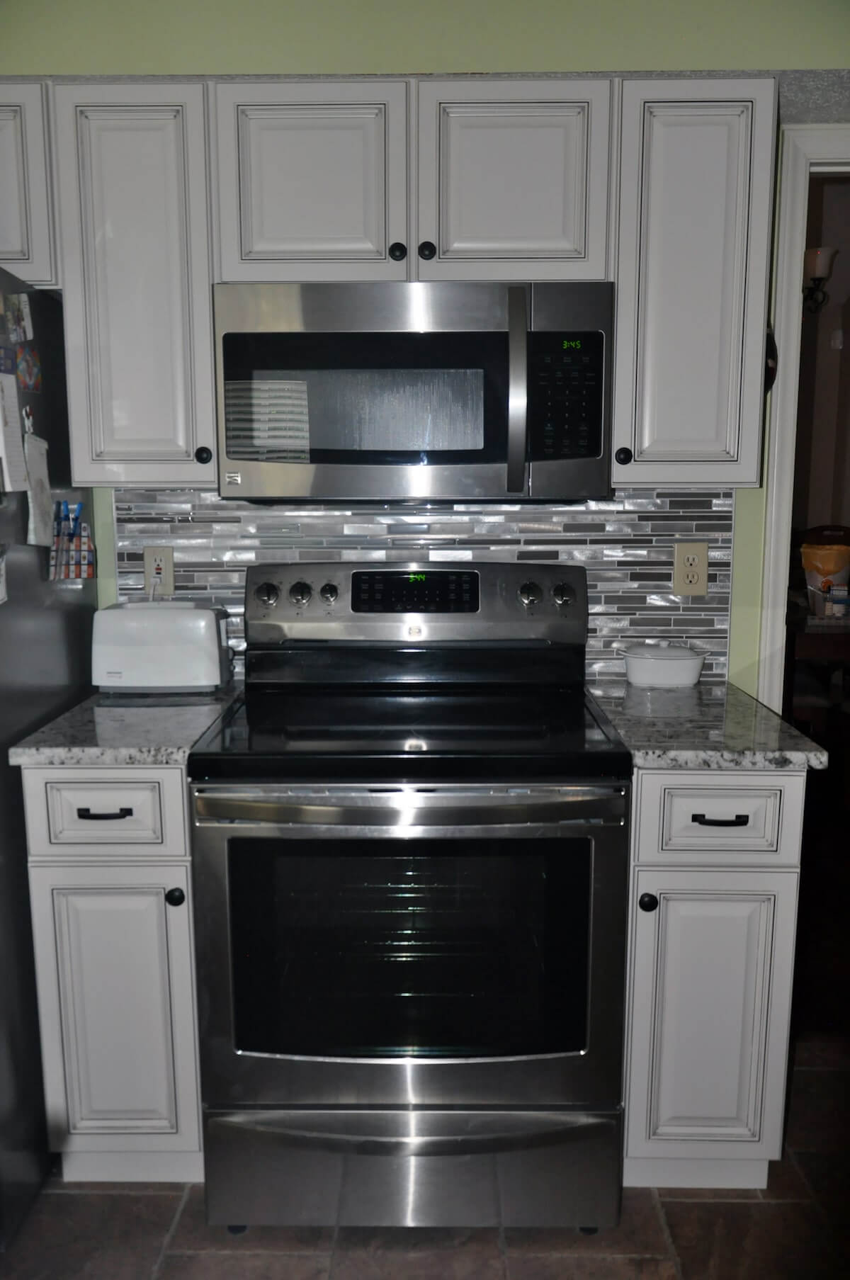 Stainless steel appliances and white cabinets