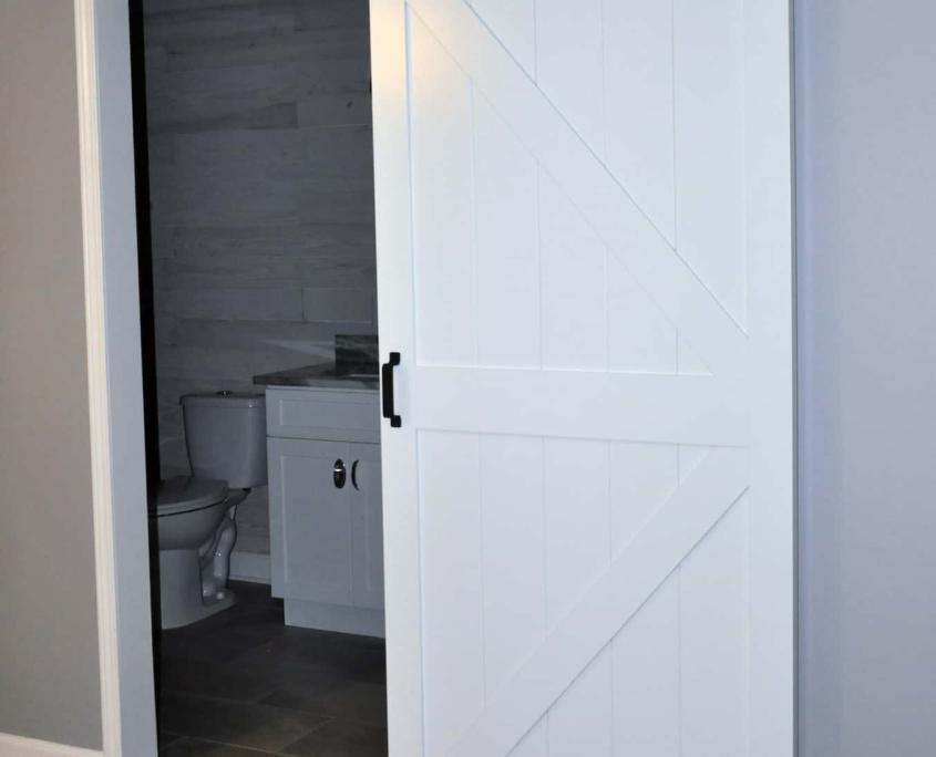 Shiplap walls double vanity bathroom barn door remodel nc