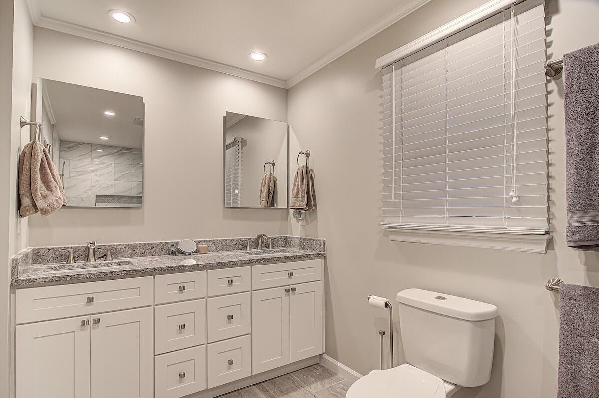 bathroom remodel granite countertops vanity backlit mirror walk in shower winston salem nc