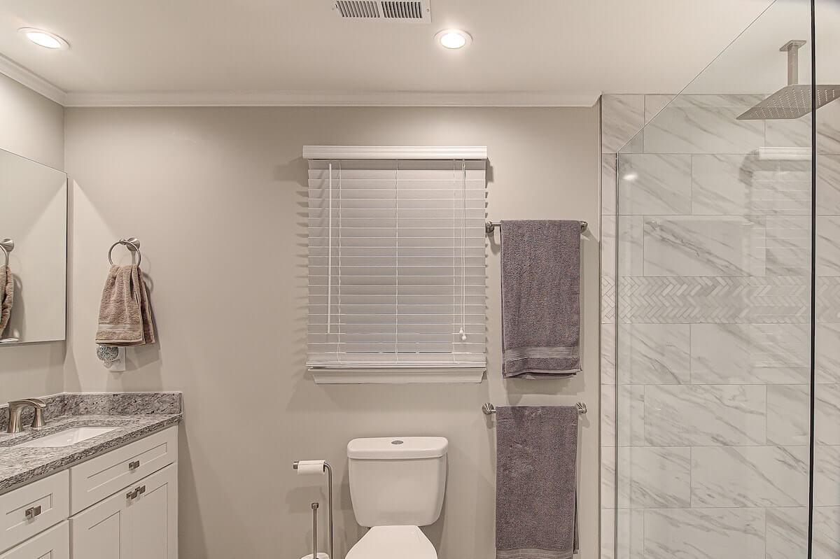 gray bathroom remodel vanity walk in shower winston salem nc