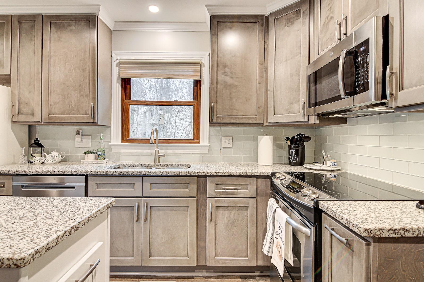 Kitchen remodel new cabinetry island granite countertops Greensboro NC