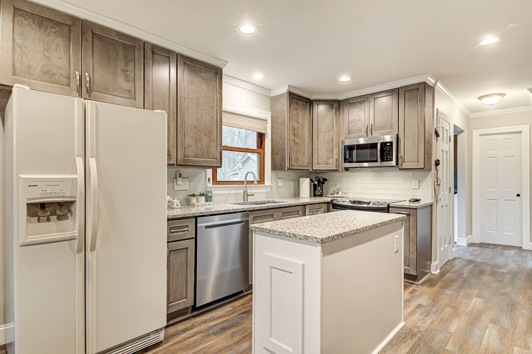 Kitchen remodel with island stainless steel appliances granite countertops Greensboro NC